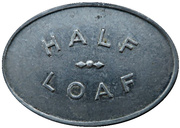 ½ Loaf Bakery Token - Newcastle & District Co-operative Limited – revers